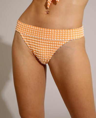 Slip di costume da bagno a quadri con texture arancio