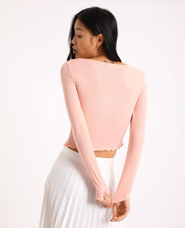 Top corto a maniche lunghe. rosa