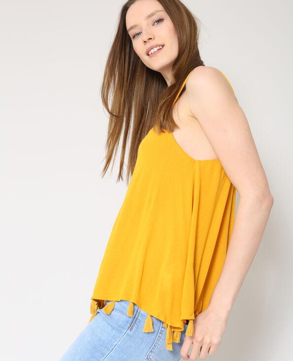 Top con pompon giallo